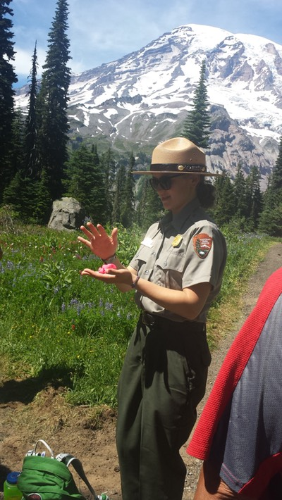 Nora the Ranger explains snowfall becoming glaciers with Play-Dough and water